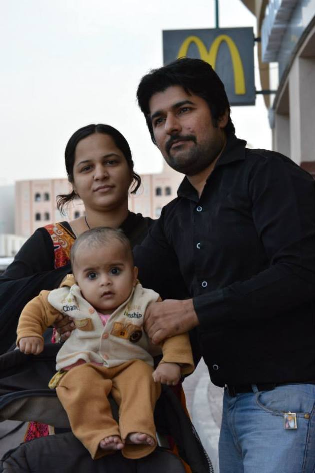 Cute Indian couple and baby